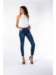 Jeans skinny con anelli e borchie