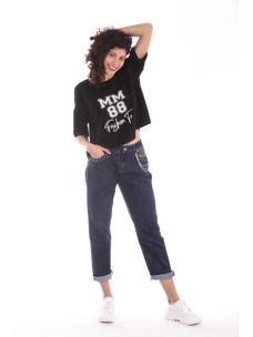 Jeans con borchie e catene